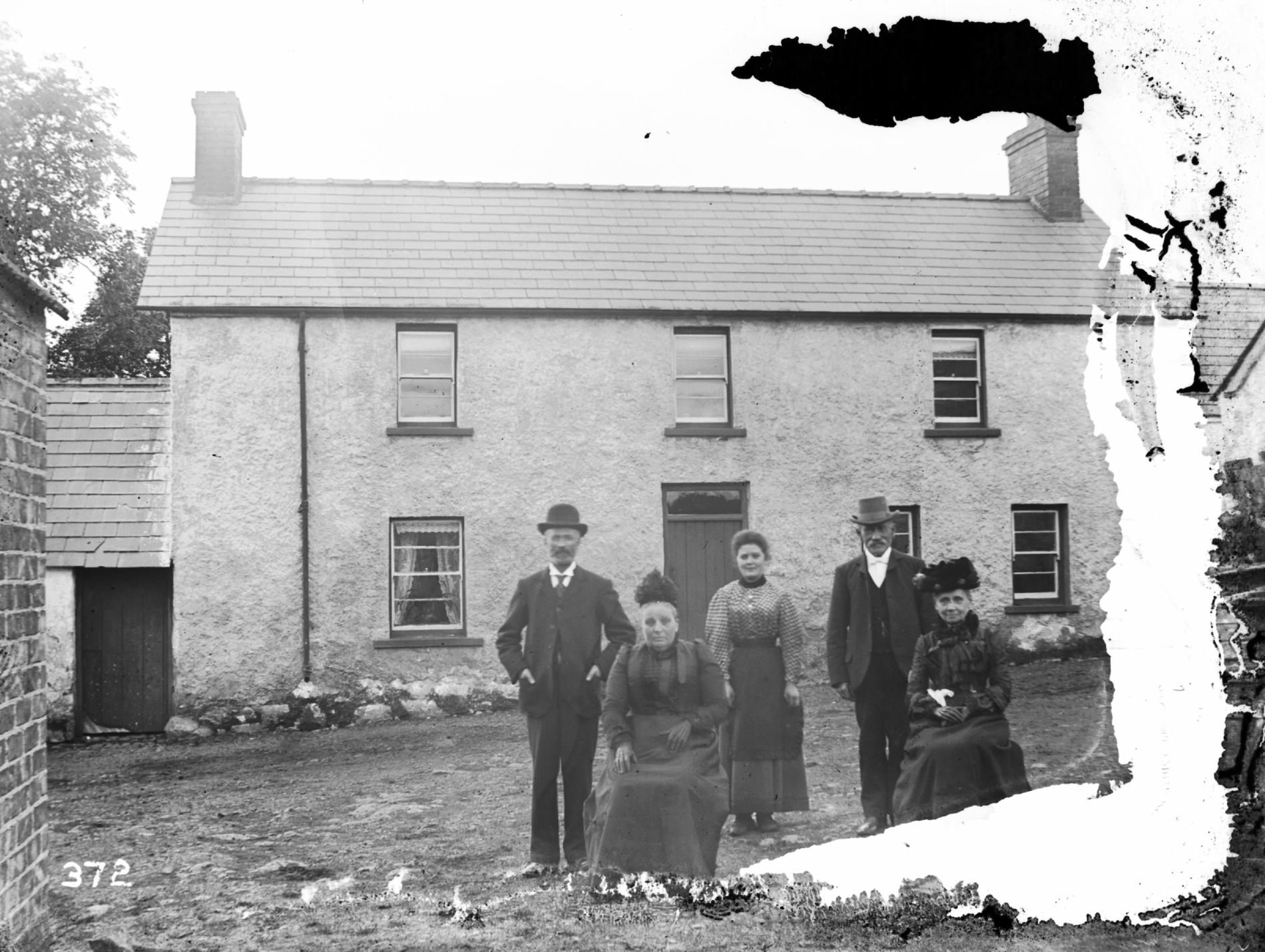 Mr & Mrs Gordon Wilson's house and group (photograph; glass plate negative)
