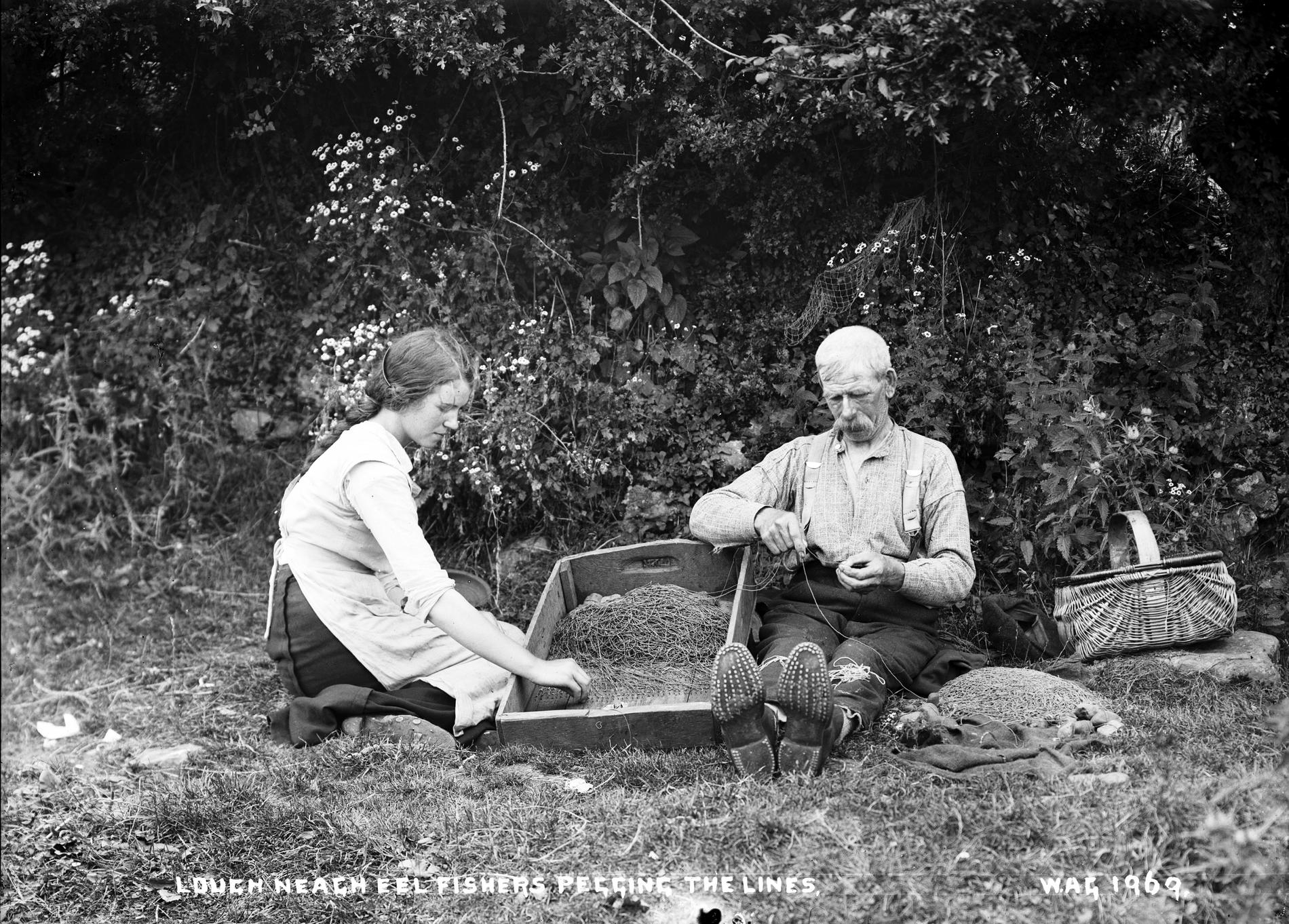 LOUGH NEAGH EEL FISHERS PEGGING THE LINES (Photograph; glass plate negative)